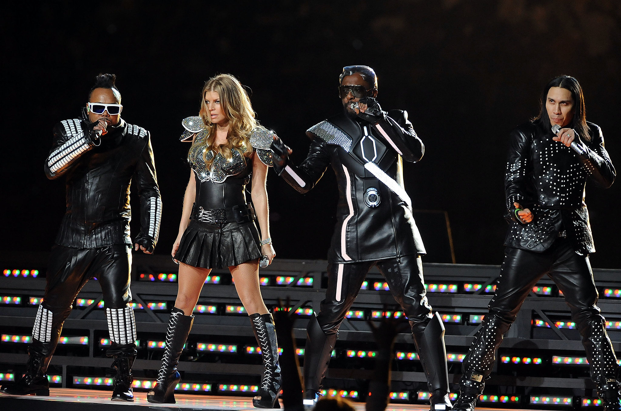 The Black Eyed Peas sported futuristic costumes while performing during the halftime show in 2011.