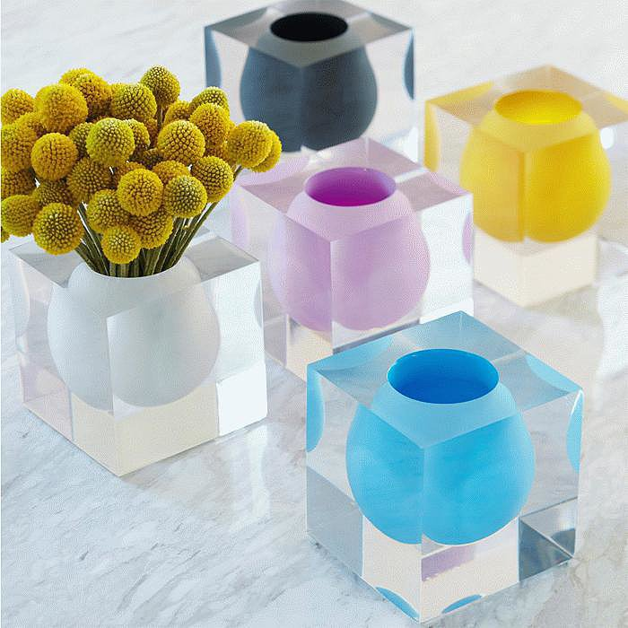 Cast in lucite, these bud vases by Jonathan Adler ($98) offer a healthy dose of color with a side of retro glam.  — AE