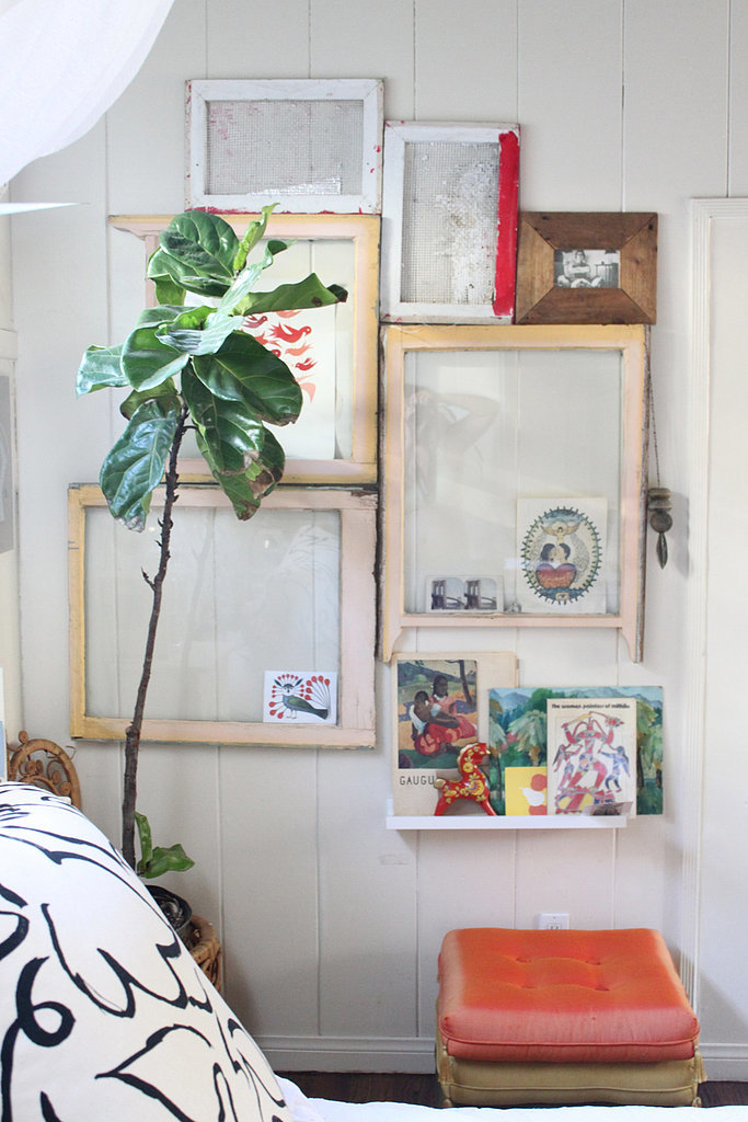 Justina's take on the gallery wall consists of vintage windows that create a cool accent wall and a unique way to showcase rotating art and photos.  Source: Justina Blakeney
