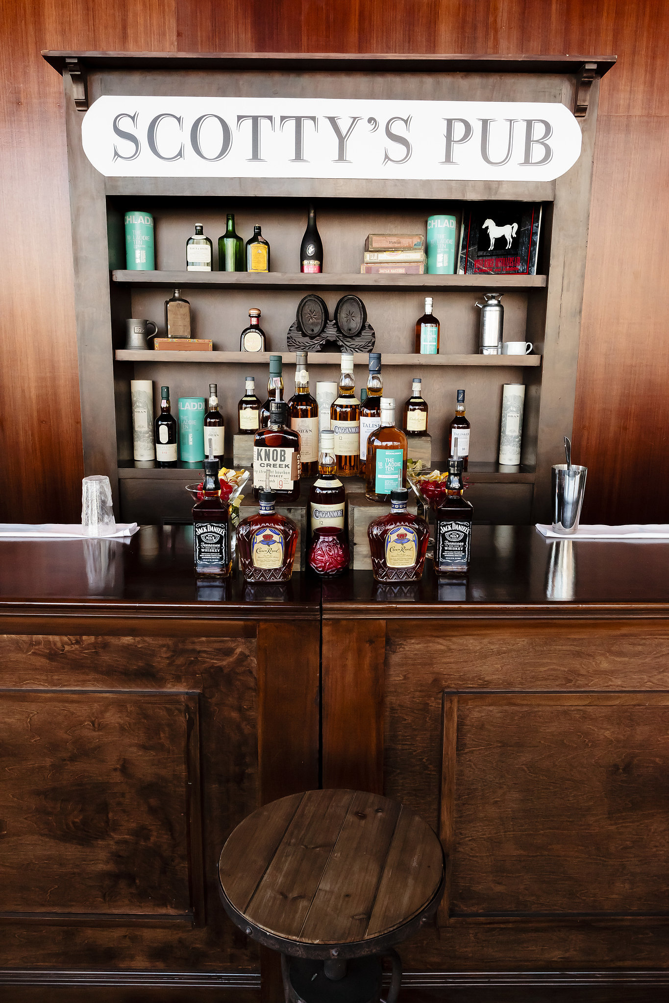 The groom's side was well represented with a scotch bar and lounge area — called Scotty's Pub after Stuart's family—filled with true scotch whiskeys that were actually brought in by his family, some that you couldn't even get here in the States.  Photo by Chrisman Studios