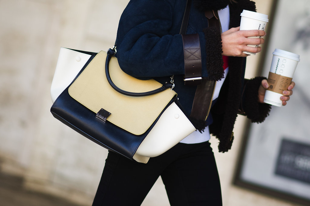 Fashion Week must haves: a chic Céline tote and a double dose of caffeine.