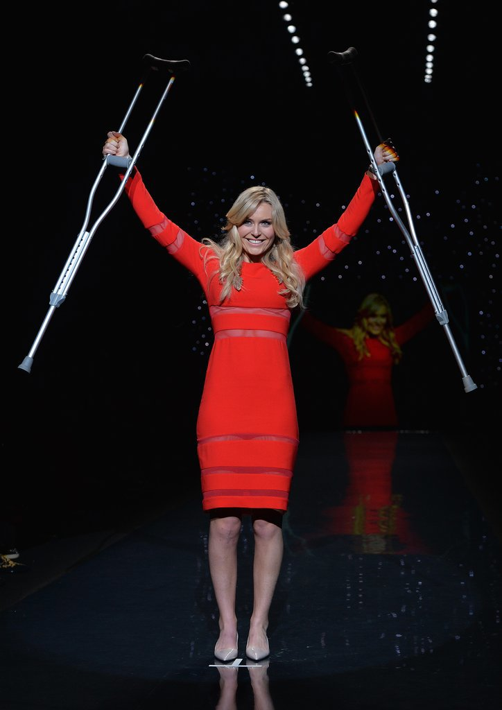 Lindsey Vonn raised her crutches in a Cynthia Rowley dress during the Heart Truth Red Dress Collection show on Friday.