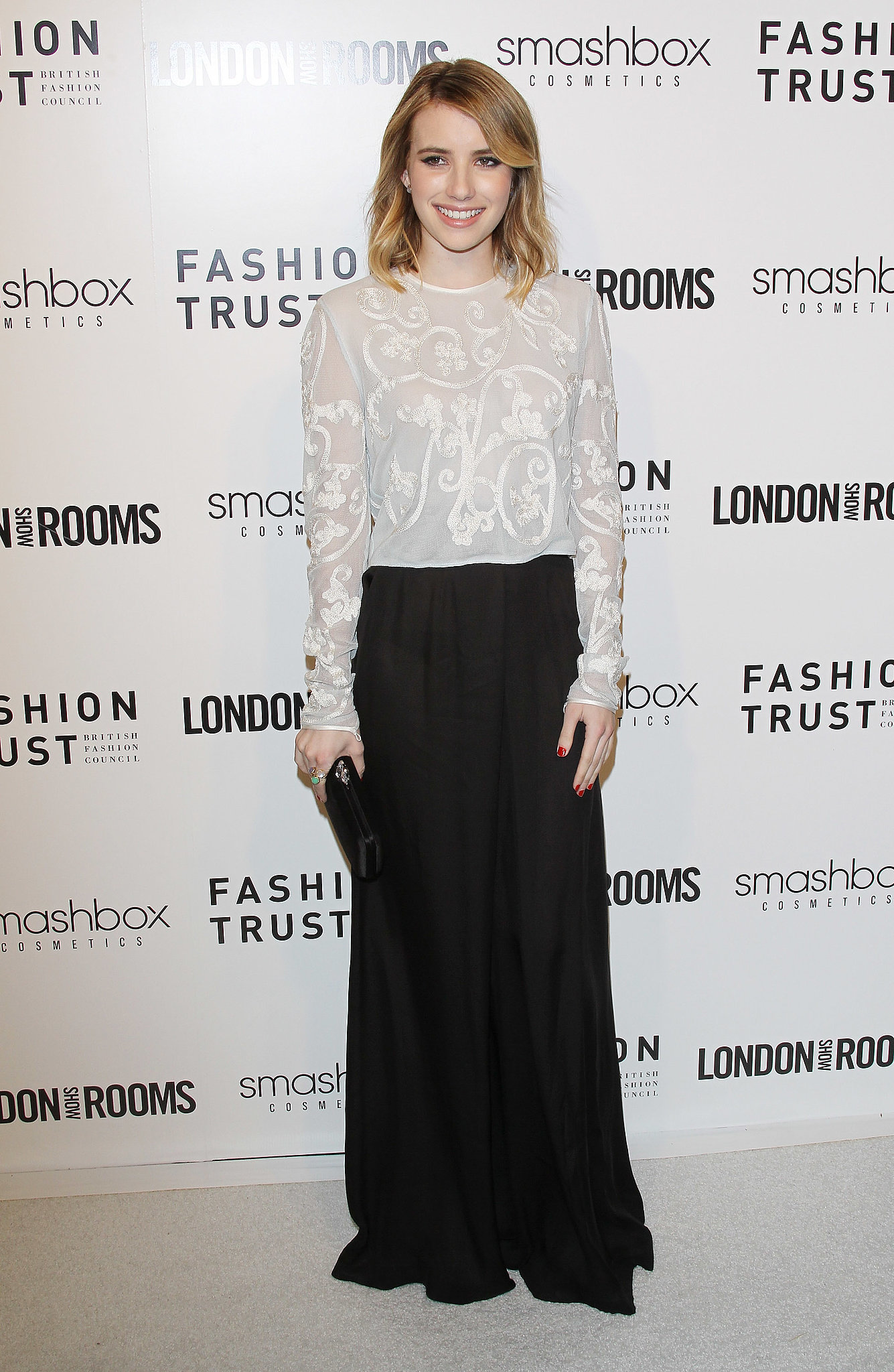 Emma tucked a lacy Jonathan Saunders top into a black maxi skirt for an event in March 2012.
