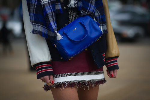 Chiara Ferragni dressed up a varsity jacket with a bright blue Saint Laurent bag.
