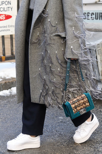 The shoes might be more laid-back, but she didn't hold back on the coat or handbag.