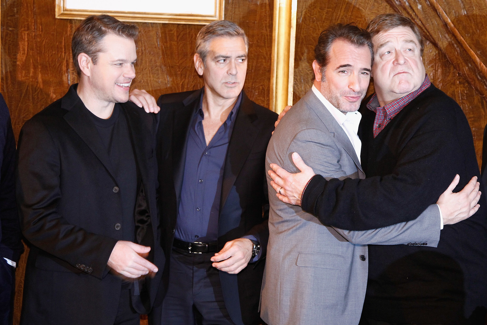 In Paris, everyone was feeling the love. Jean and John shared a hug, but George looked kind of jealous.