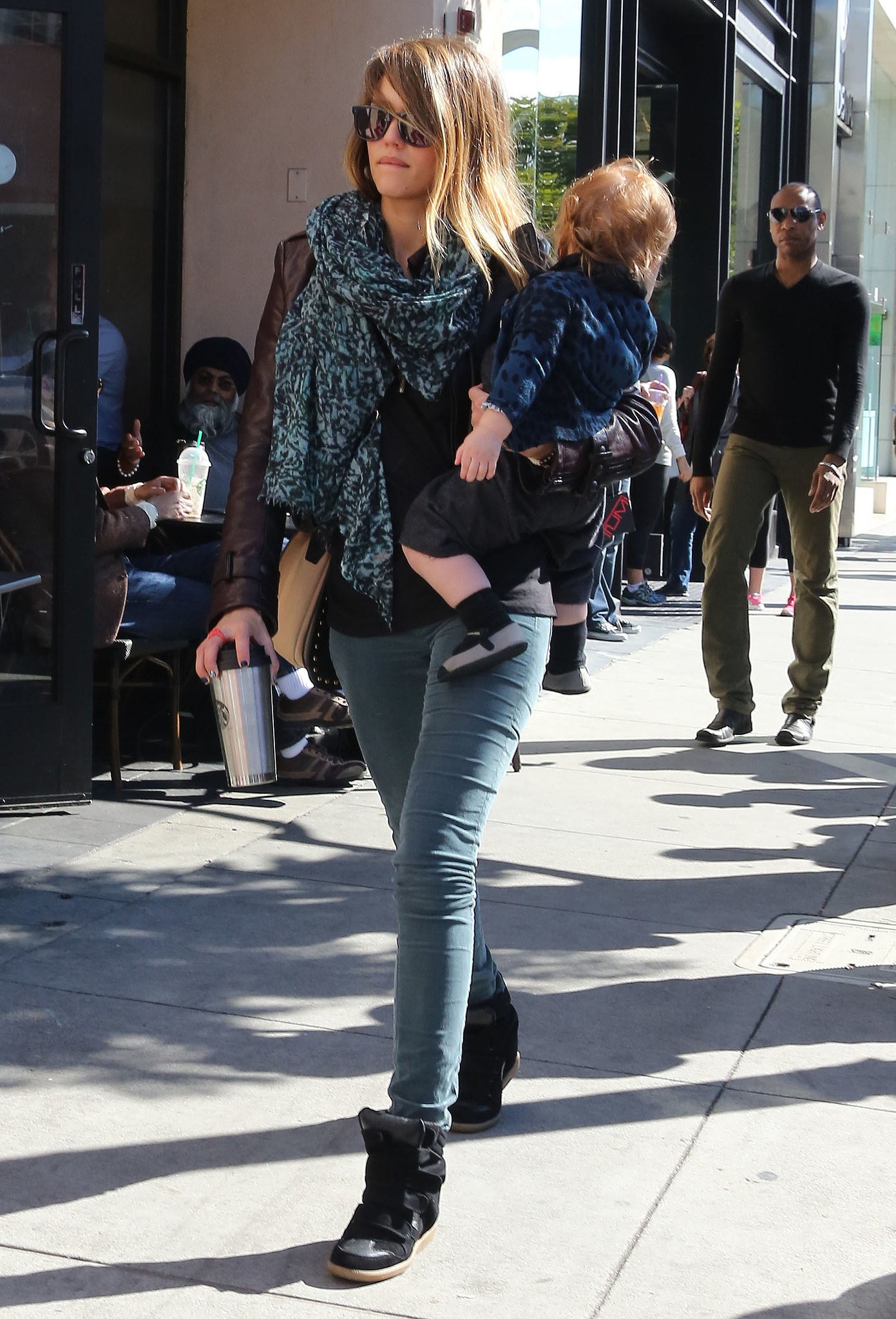 Jessica made a case for cargos, pairing them with trendy Isabel Marant wedged sneakers and a printed scarf while grabbing a coffee in Beverly Hills.
