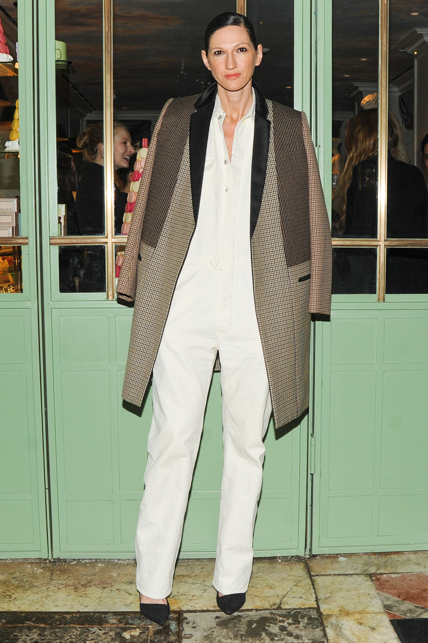 A simple white jumpsuit might be the painter's go-to uniform, but it's automatically ready for a downtown sophisticate thanks to the addition of a tailored overcoat.
