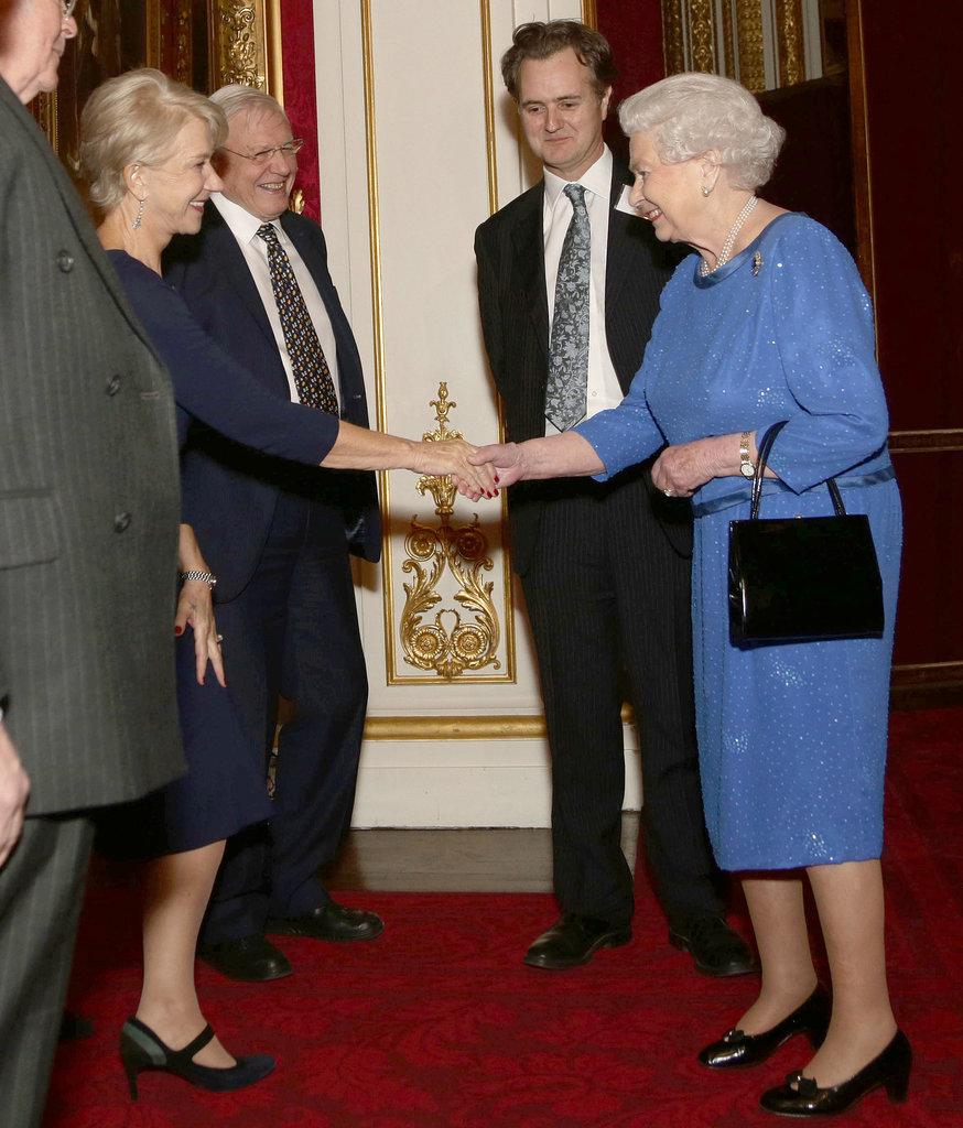 Queen Elizabeth shook hands with Helen Mirren, who has portrayed her in the past.