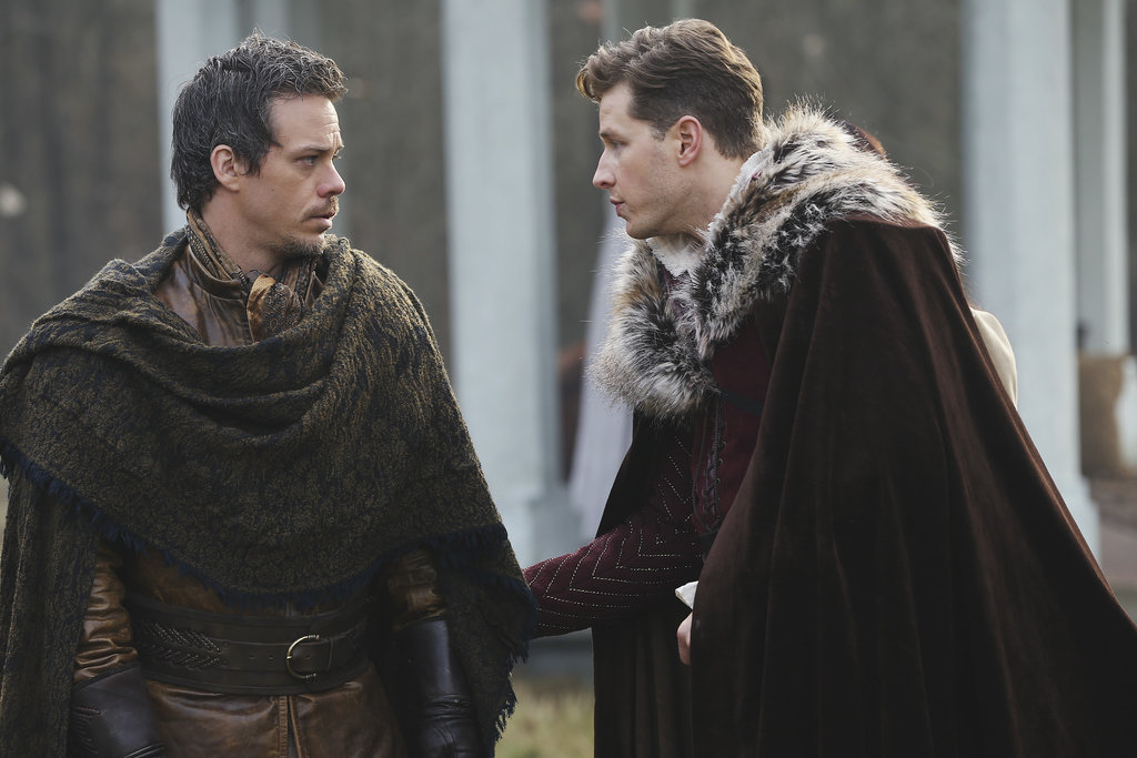Neil/Bae and Charming confer.