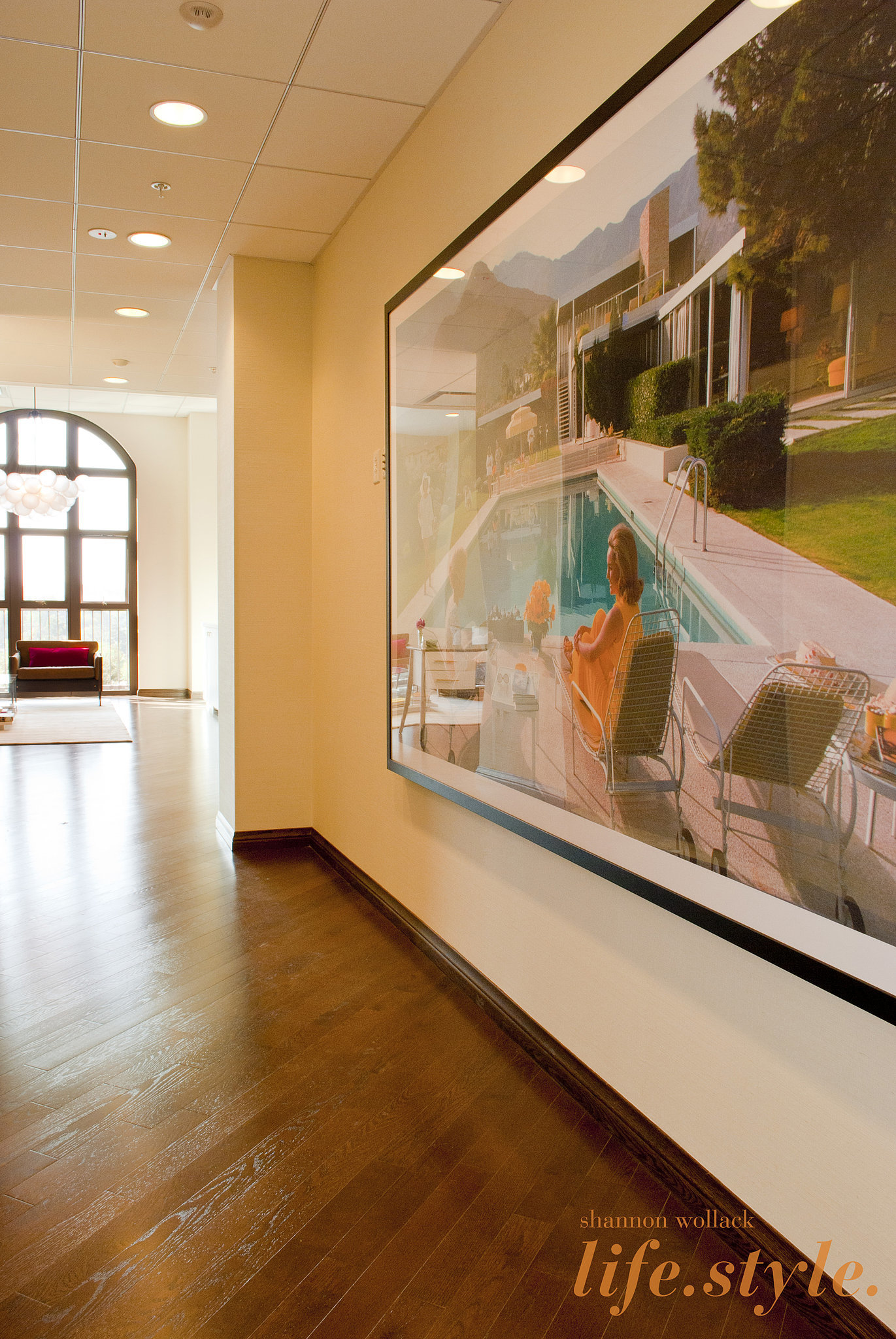 A large Slim Aarons print complements the midcentury decor sprinkled throughout the office.