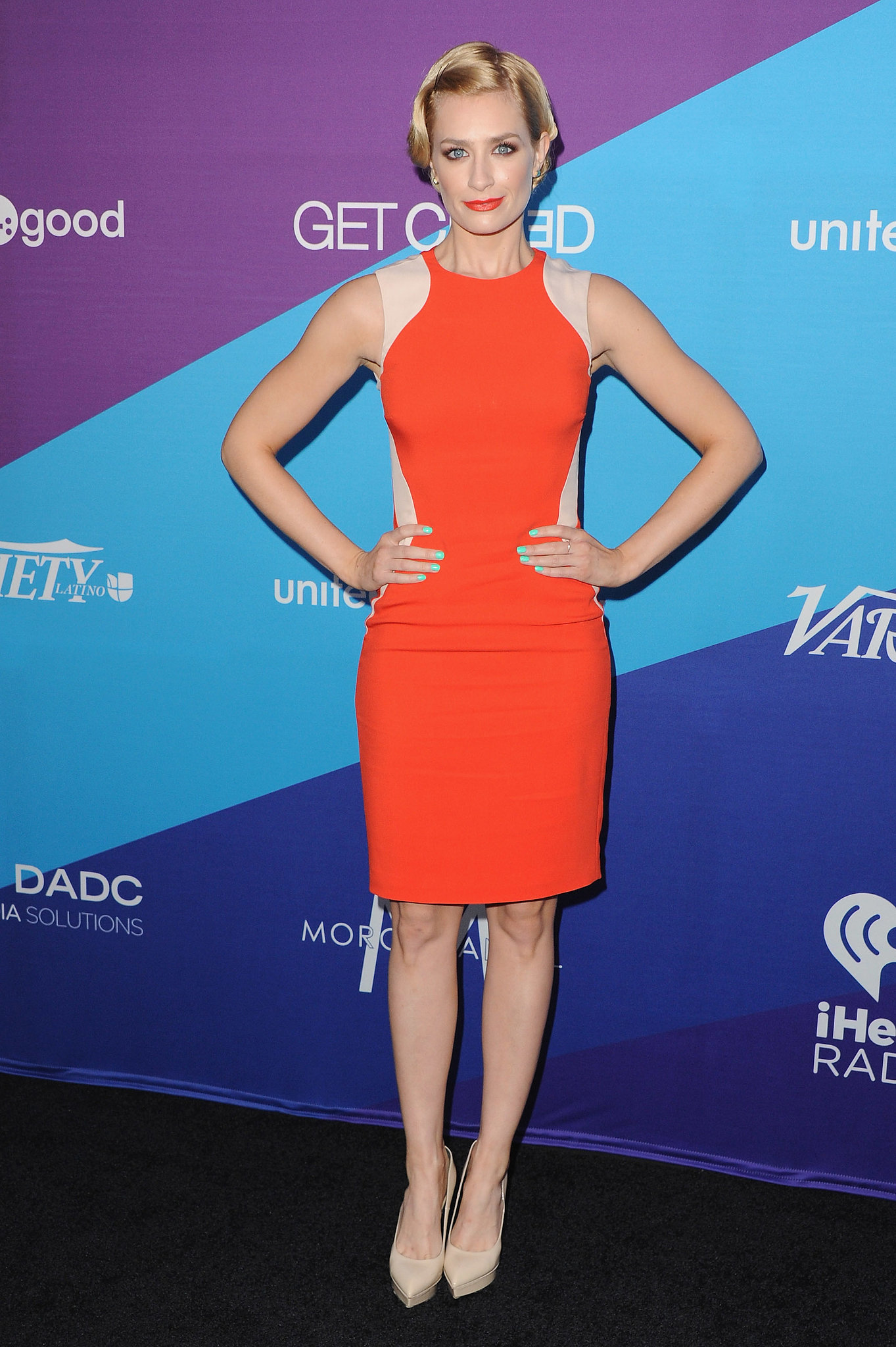 Beth Behrs dazzled in orange.