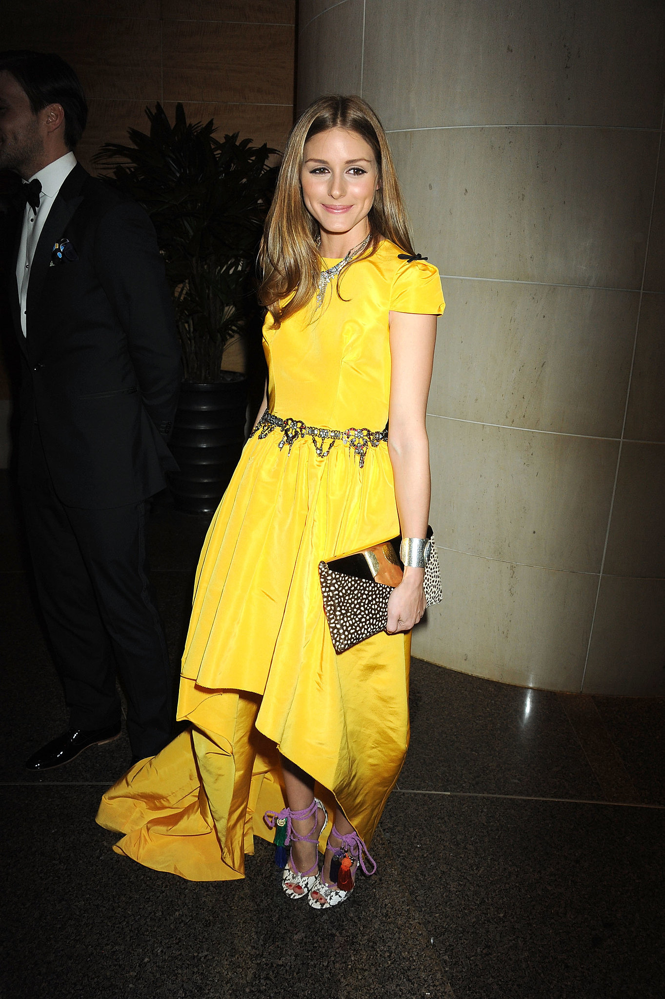 Olivia added drama to a bright Katie Ermilio with a pair of ankle-wrap heels at party in April 2013.