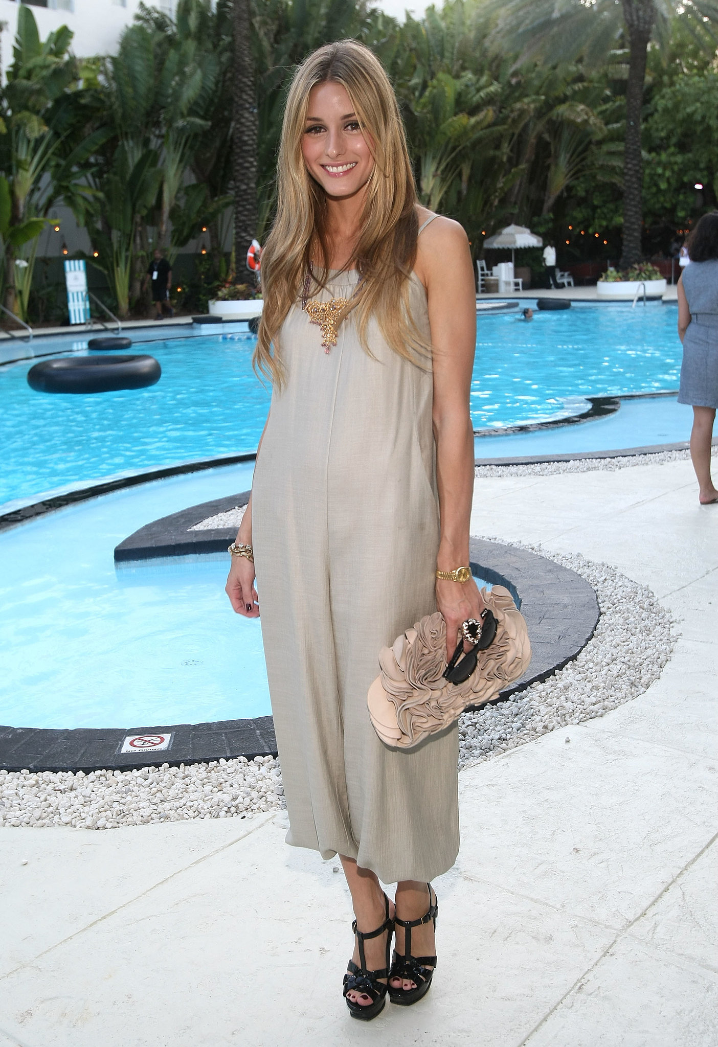 Poolside-chic in a summery frock and eclectic add-ons in Miami in June 2009.