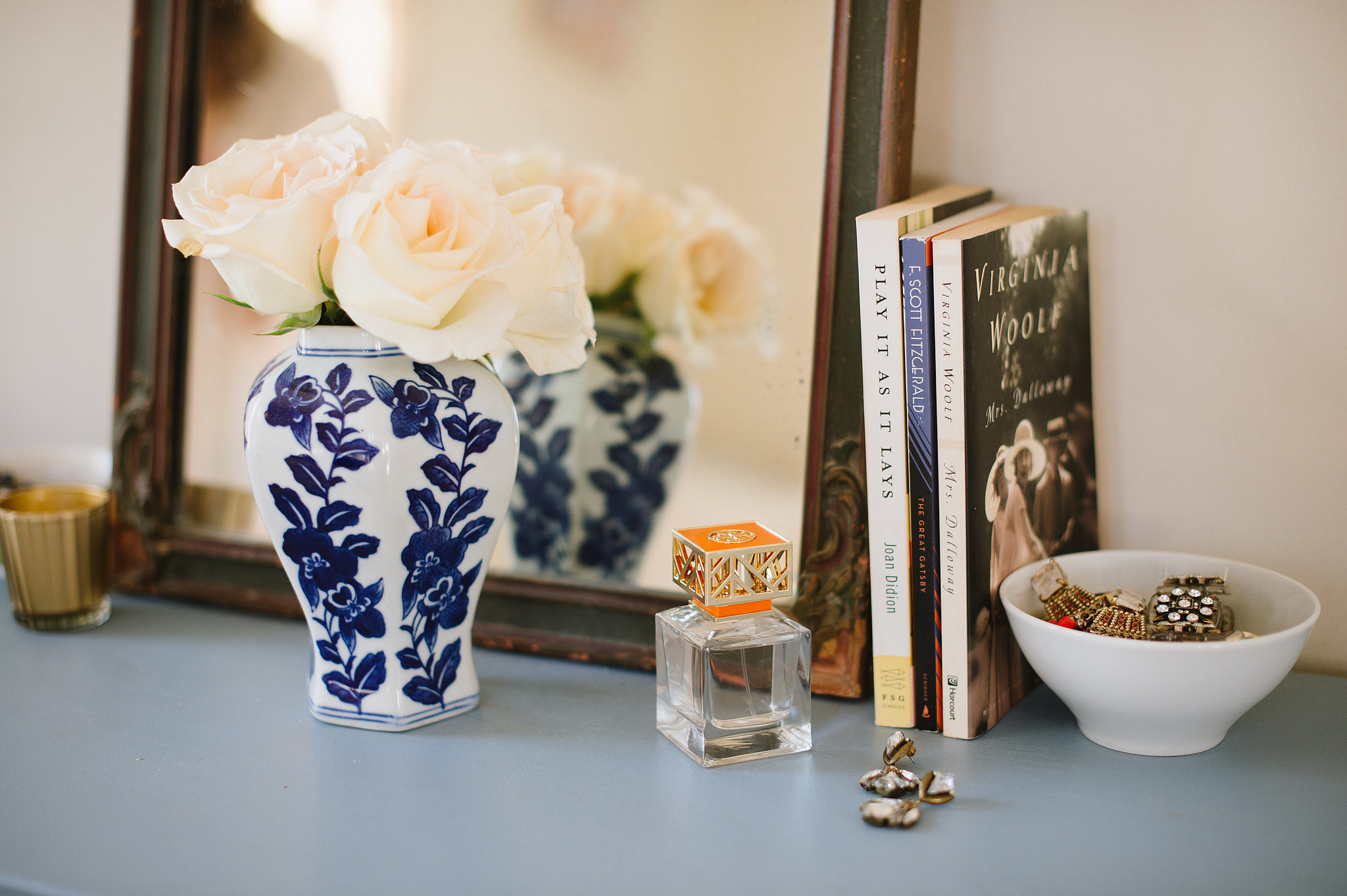 Flowers are a must for any space, especially when displayed in a vintage vase.  Source: Natalie Franke