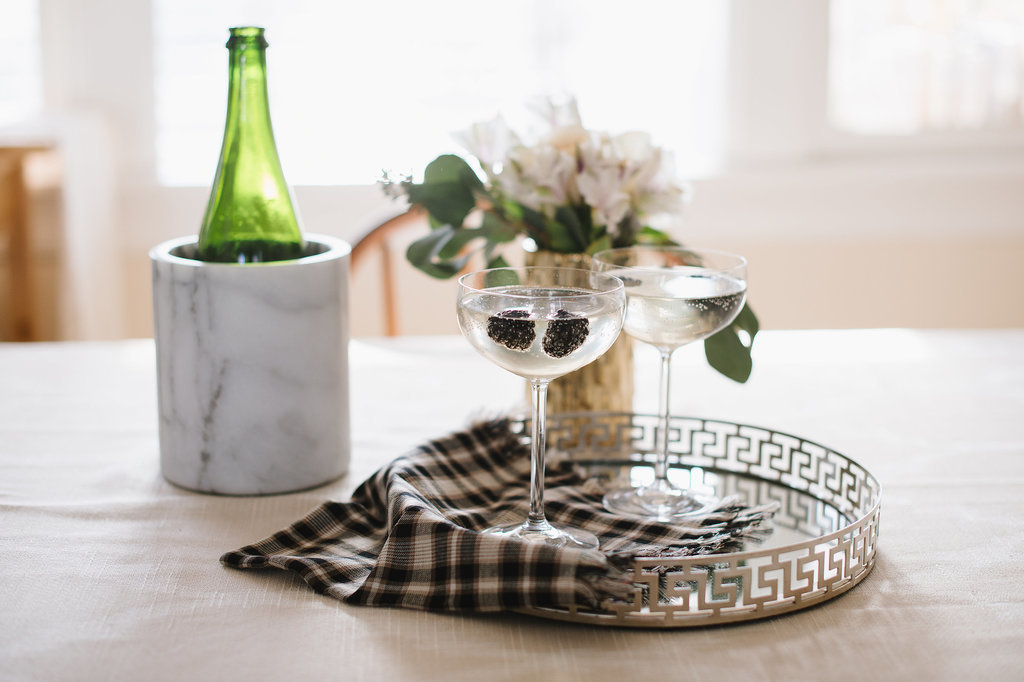 Small touches like a wine cooler ($30) and a tray are entertaining essentials worth having on hand.  Source: Natalie Franke
