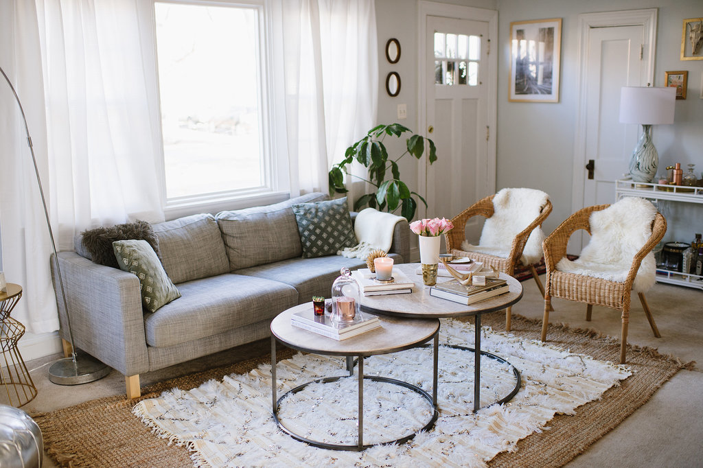 Throughout her home, Caitlin chose a neutral color palette and accessorized with eclectic touches. Opting for gray hues also means she can easily change out pillows and throws with each season.  Source: Natalie Franke