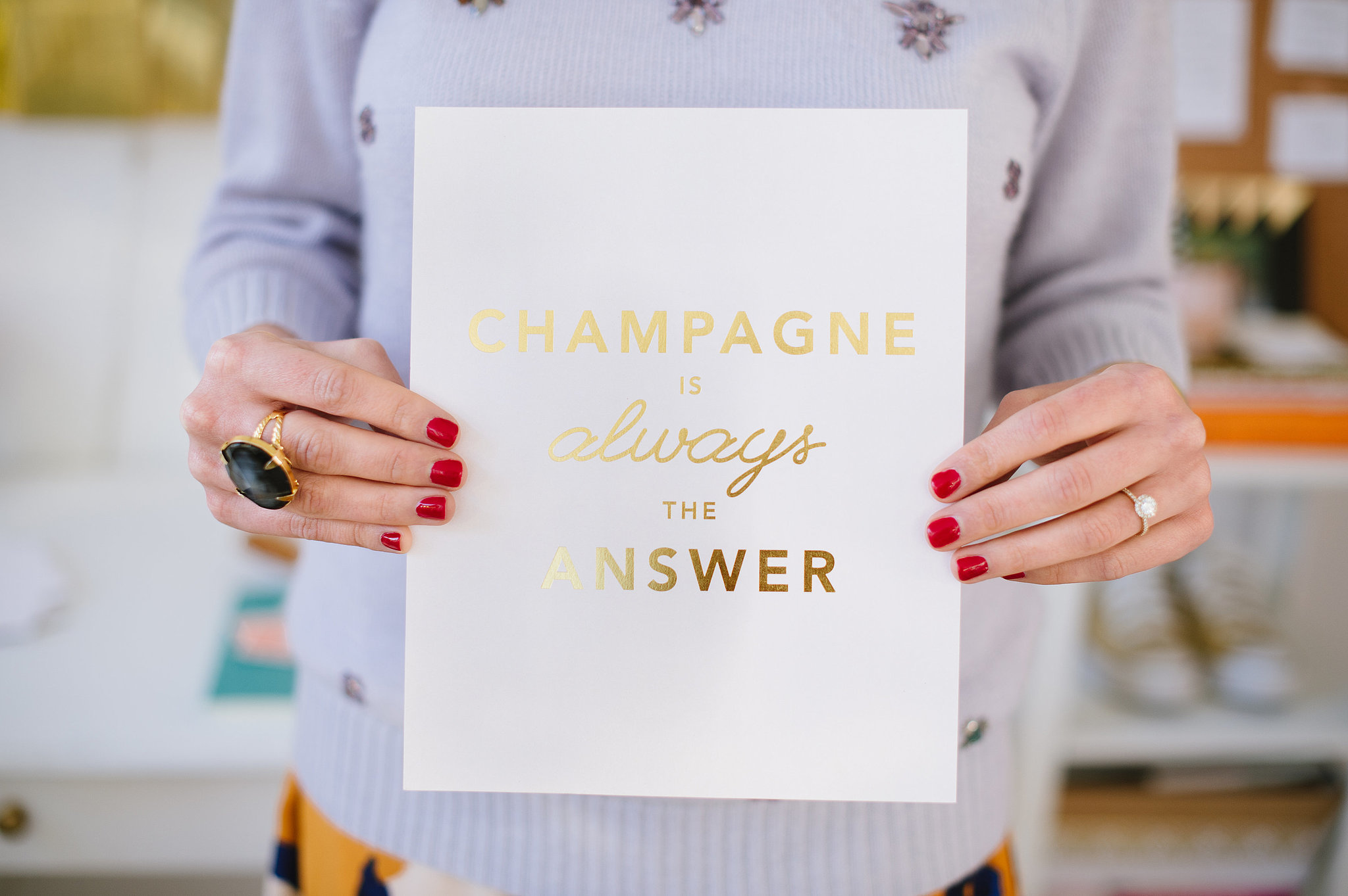 Cheeky prints fill Caitlin's home and are proof that art doesn't have to break the bank. This Champagne print is only $30!  Source: Natalie Franke