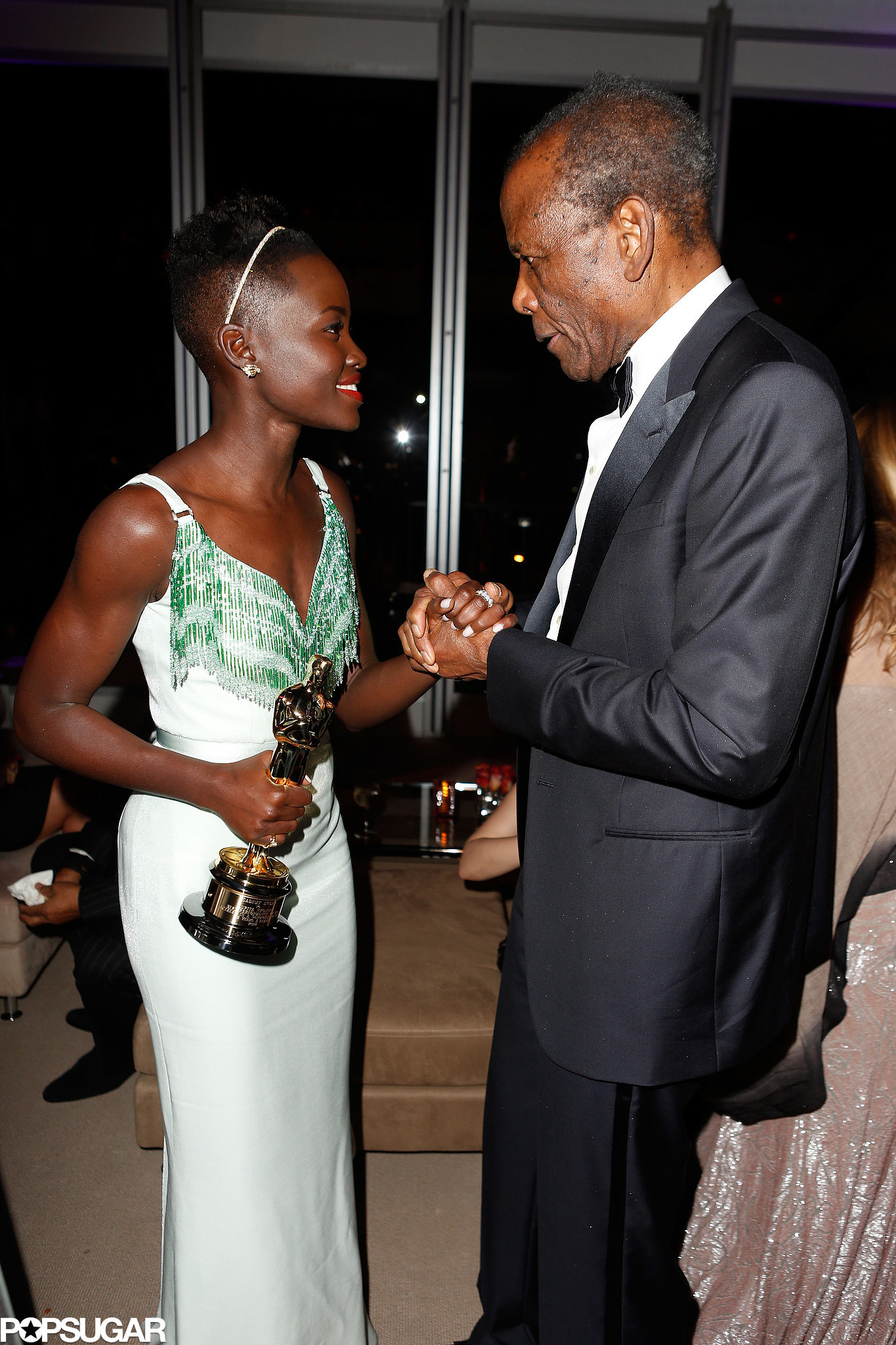Lupita Nyong'o got a sweet handshake from legendary actor Sidney Poitier.