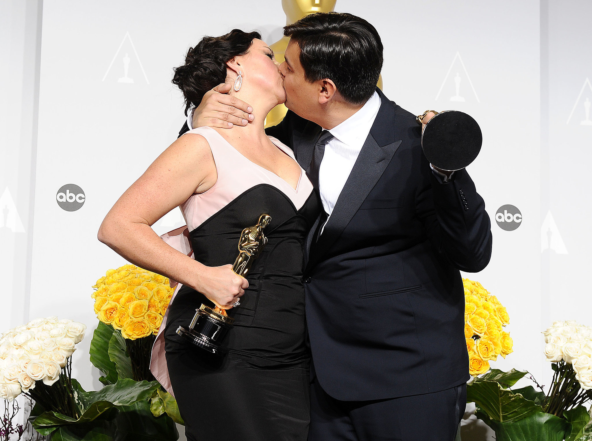 """The husband-and-wife team behind Frozen's """"Let It Go,"""" Robert Lopez and Kristen Anderson-Lopez, had a hot makeout after winning their Oscar."""