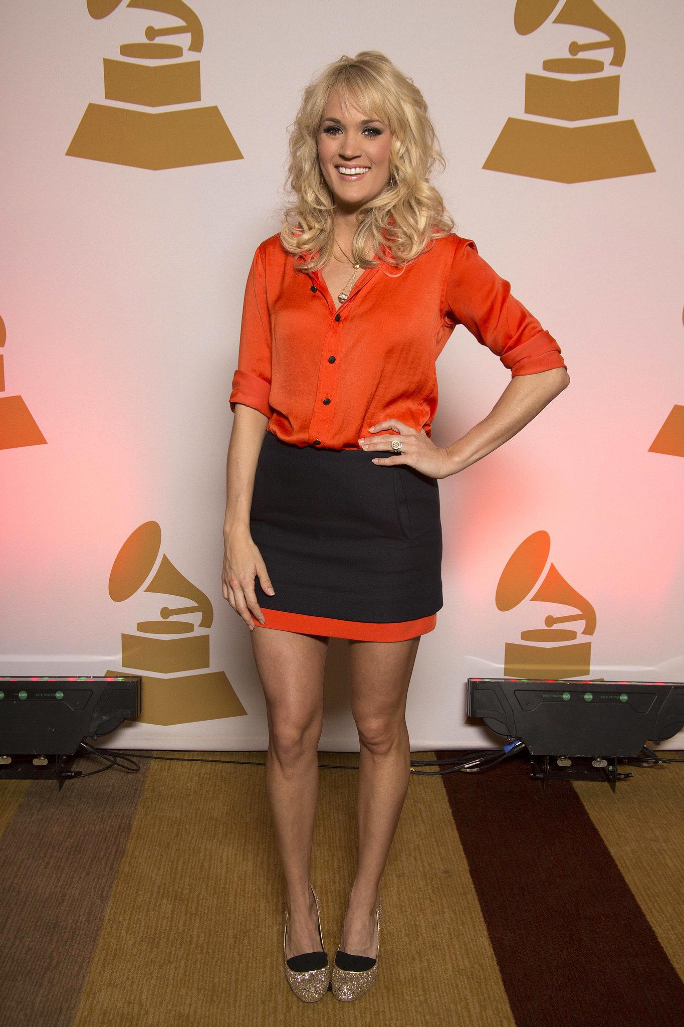 Carrie brightened her orange-and-navy colorblock Diane von Furstenberg skirt with gold Stella McCartney glitter pumps in January 2013.