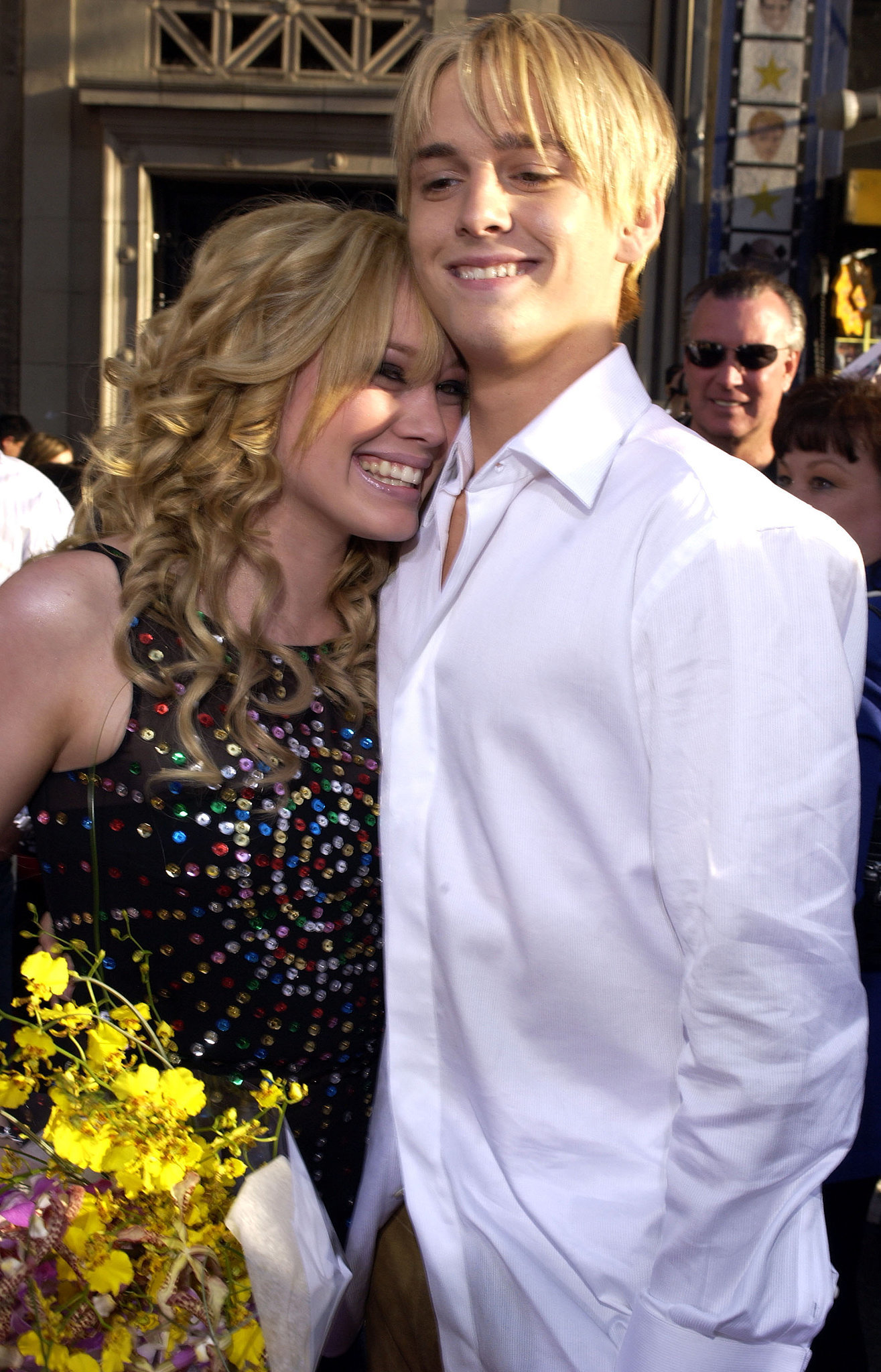 In April 2003, Aaron surprised her with flowers at the premiere of The Lizzie McGuire Movie.
