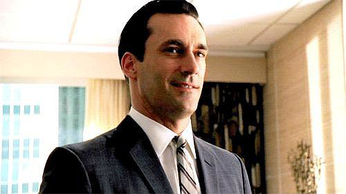 Don Draper can switch gears and be smiley.