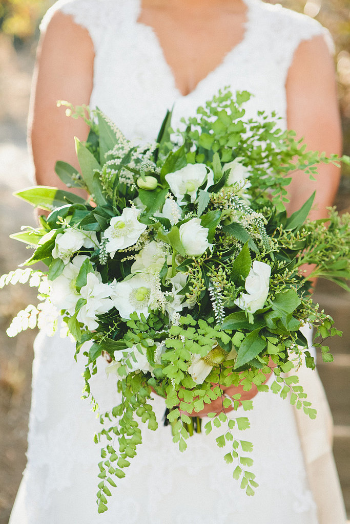 A green and white bouquet pops against a gown and is fitting for a vintage wedding.     Photo by  onelove photography via Style Me Pretty
