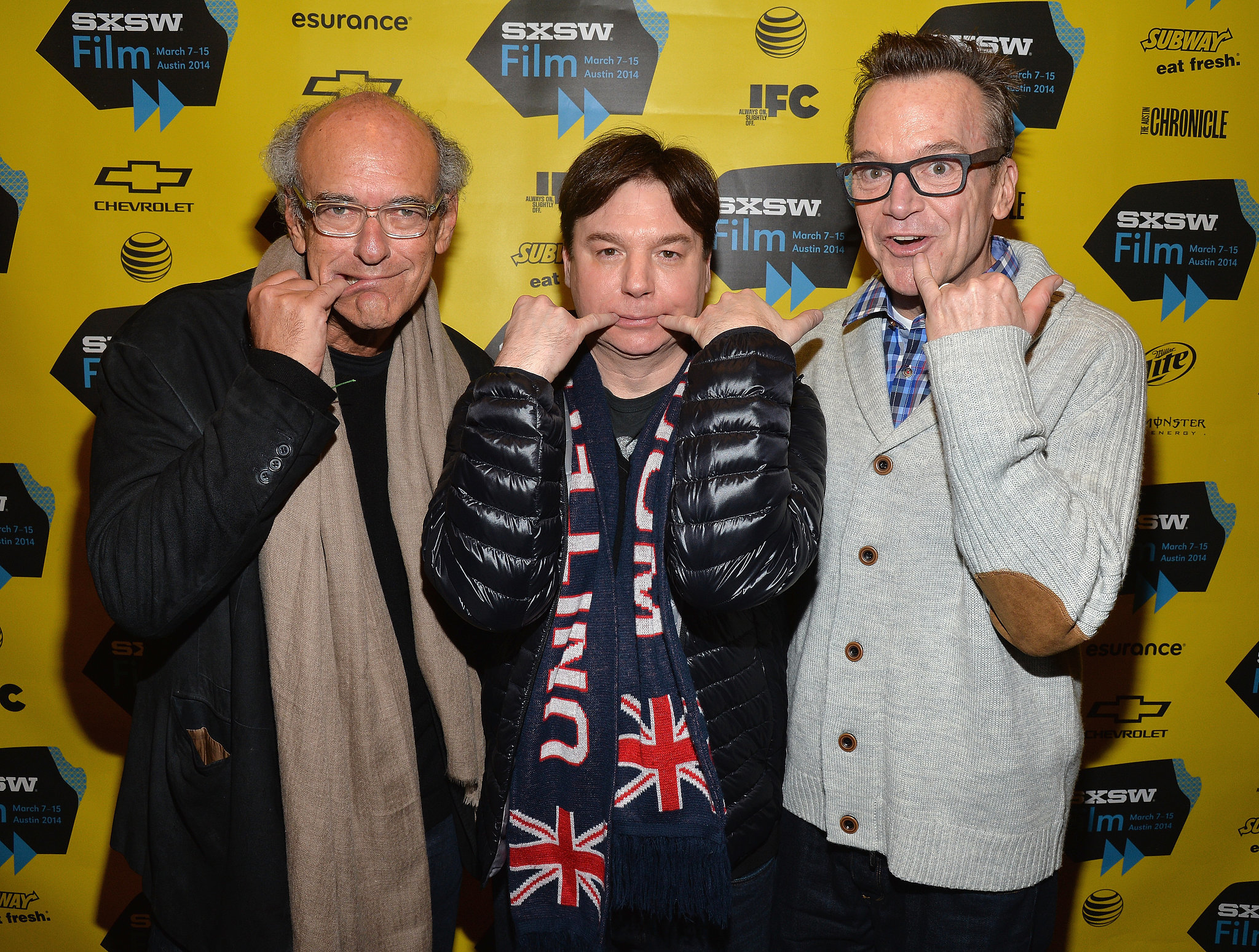 "Mike Myers did his signature ""Mini-Me"" pinky pose from Austin Powers with Tom Arnold and Shep Gordon at their Supermensch premiere on Sunday."