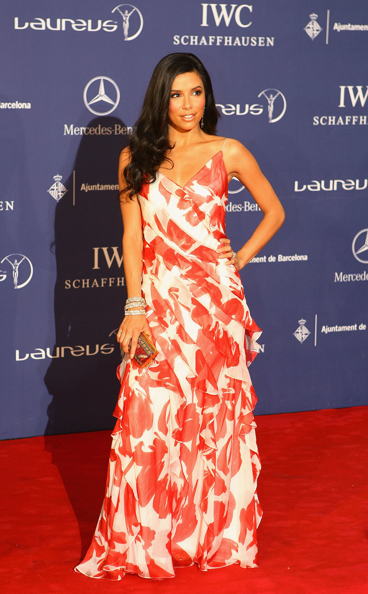 Longoria wowed in a whimsical Carmen Marc Valvo at the 2007 Laureus World Sports Awards. A few layers of sparkling bangles, a gilded box clutch, and sideswept waves completed her party look.