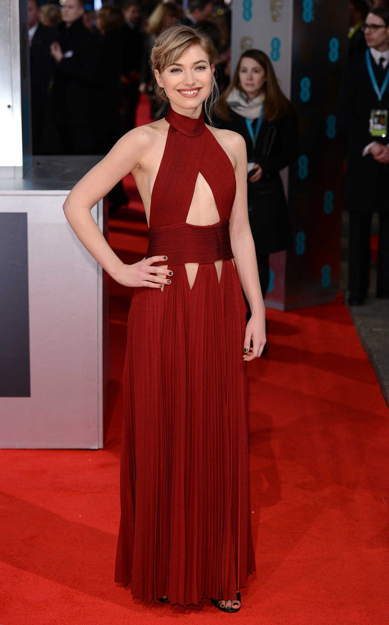 At the BAFTA Awards, Imogen wore a dramatic red cutout gown by Givenchy.