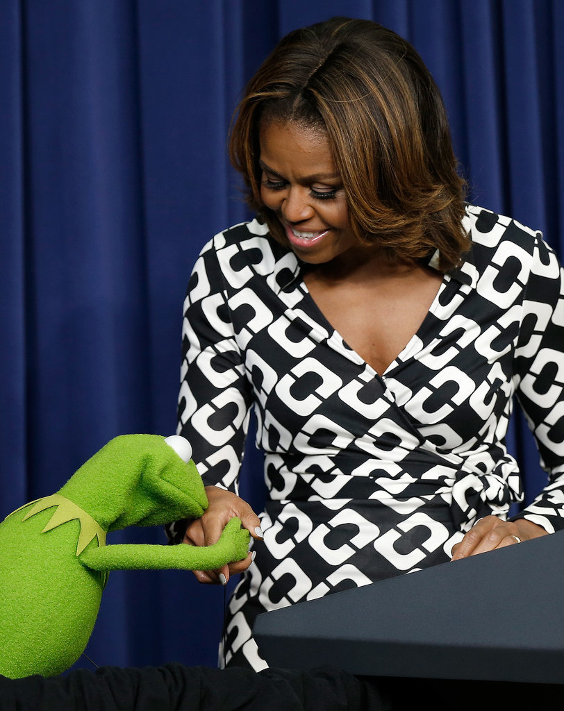 He gave the first lady a little kiss.