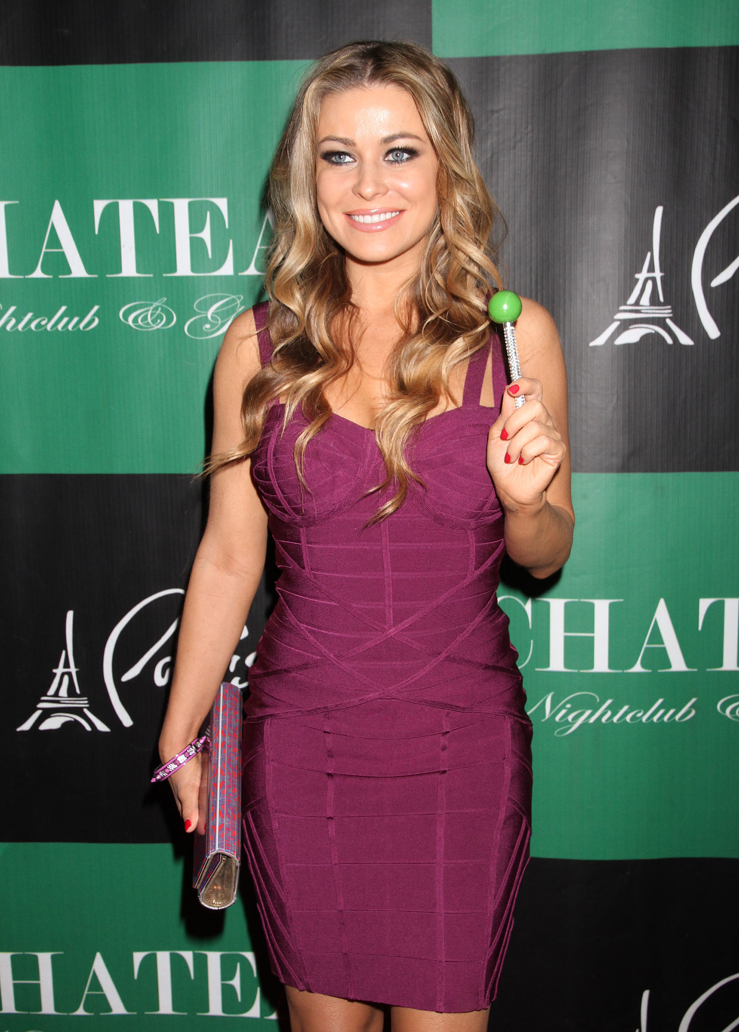 Carmen Electra posed on the red carpet with a neon green lollipop in March 2012 for a St. Patrick's Day event in Las Vegas.