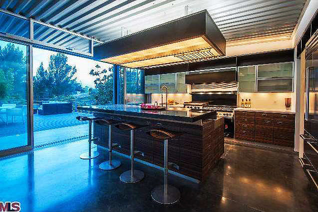 The open kitchen is complete with a Wolf range and Sub-Zero refrigerator.   Source: Redfin