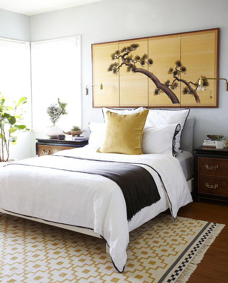 Sticking with a palette of brown, black, and gold helped to unify the bedroom's mix of Asian, midcentury, and modern pieces.  Photo by Zeke Ruelas via Homepolish