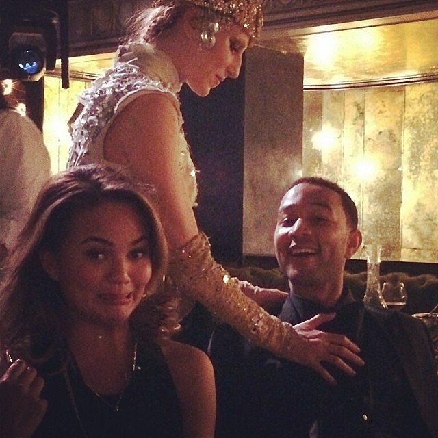 "Chrissy Teigen shared a snap of someone getting handsy with her husband, John Legend: ""aaaaahhahaah #getit."" Source: Instagram user chrissyteigen"