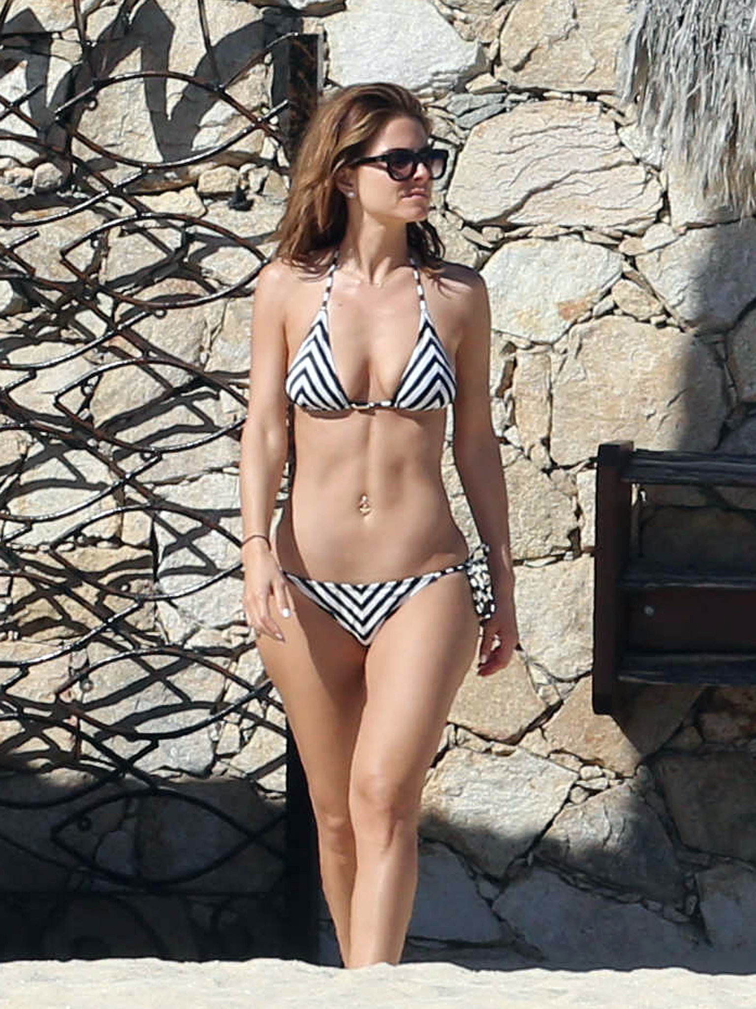 In January 2014, Maria Menounos donned a striped swimsuit in Cabo.
