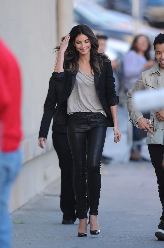 It doesn't take anything flashy to put together a fabulous outfit: Lily Aldridge combined black pants with a blazer, heels, and a light tank top.