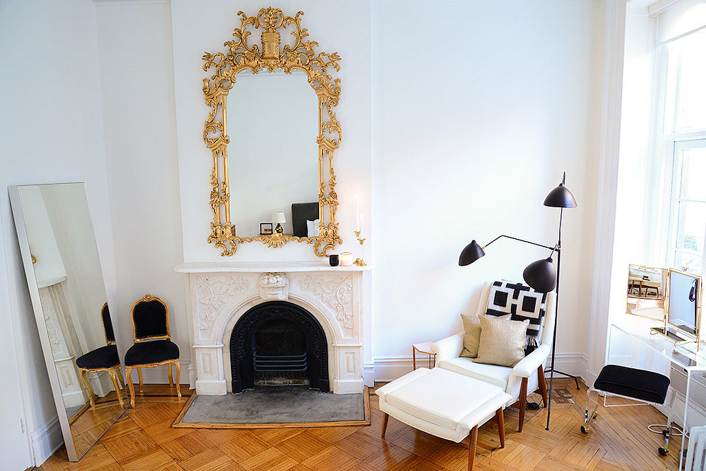 With a fireplace facade as regal as this, it only seems fitting to work in some gold rococo. By surrounding it with simple, modern pieces and a black-and-white color palette, the mirror feels anything but gaudy.  Source: Homepolish