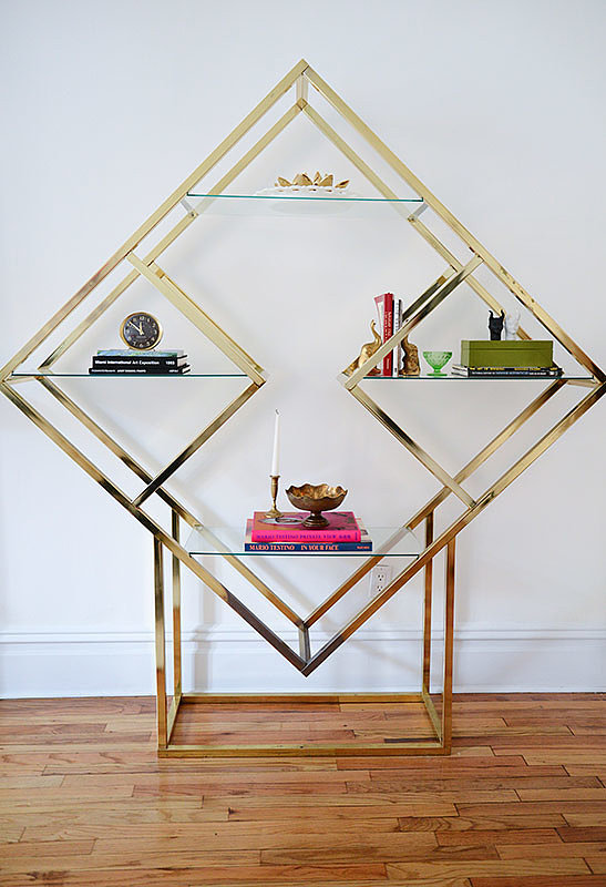 """When Casey stumbled upon this rare brass étagère shelving unit in pristine condition, she pounced on it. """"It was great to accessorize!"""" said Casey.   Source: Homepolish"""