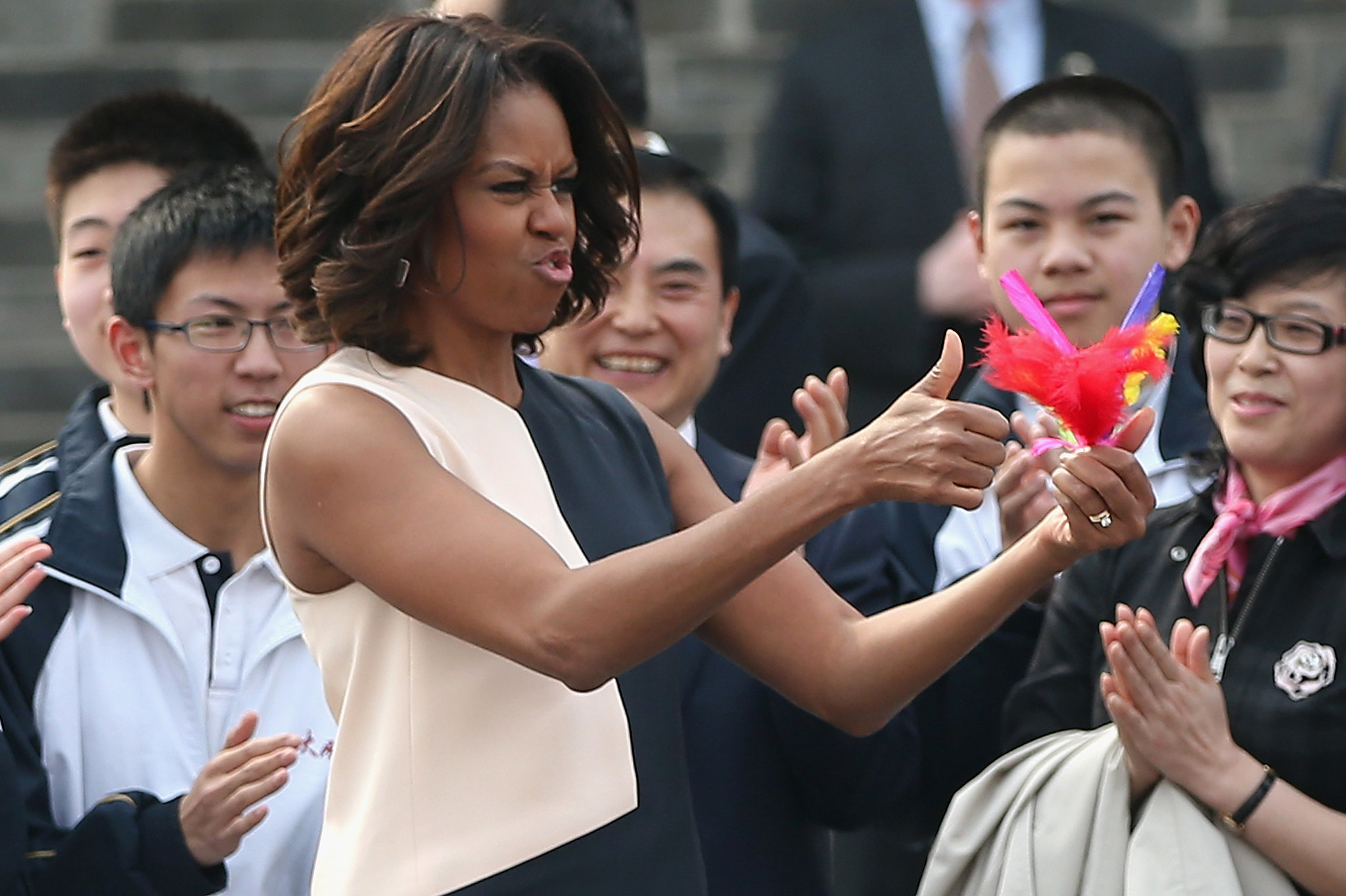 The first lady gave two thumbs-up while visiting Xi'an with her mom and daughters.
