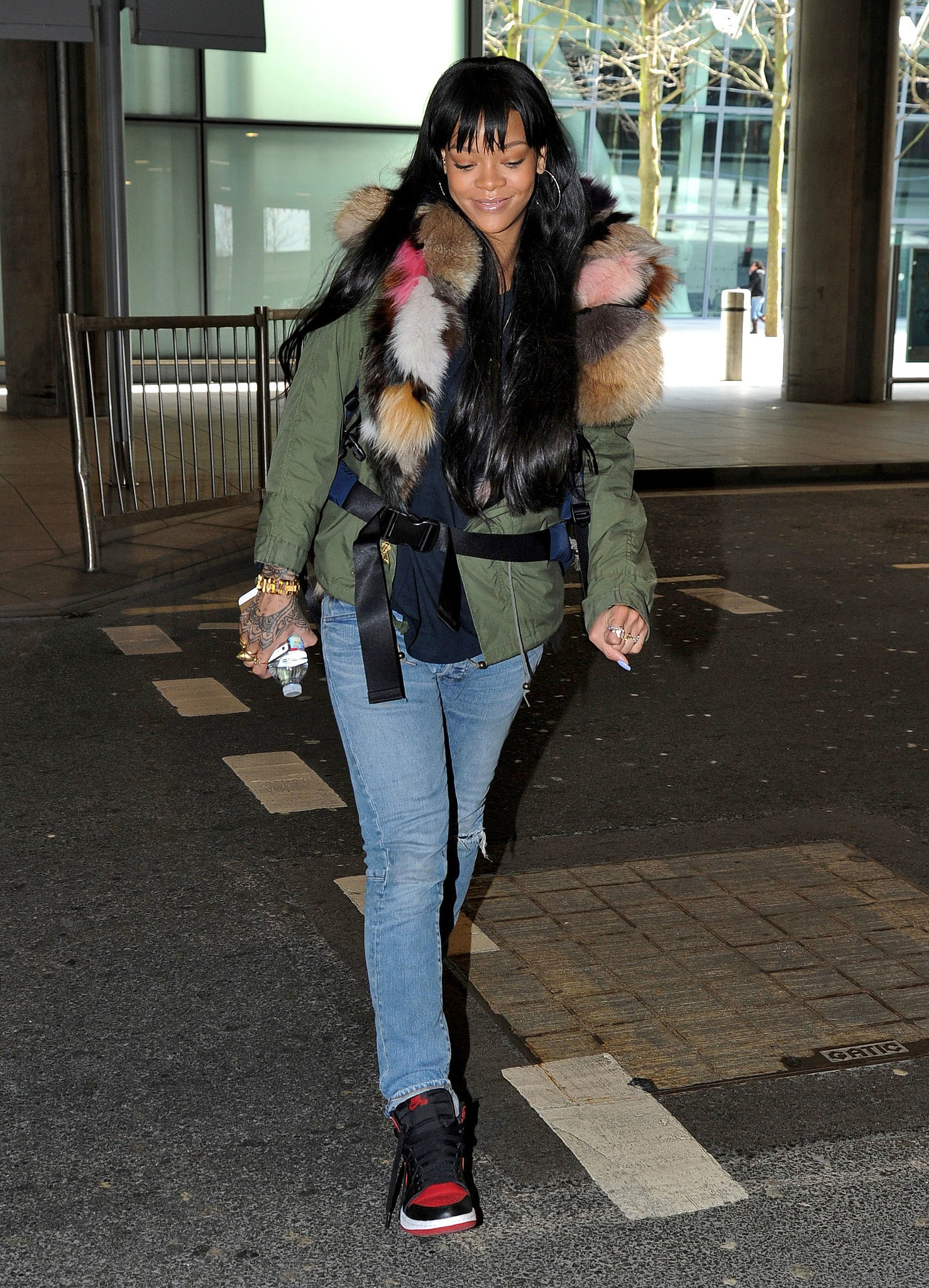 Rihanna arrived in London on Sunday while wearing an eccentric fur jacket.