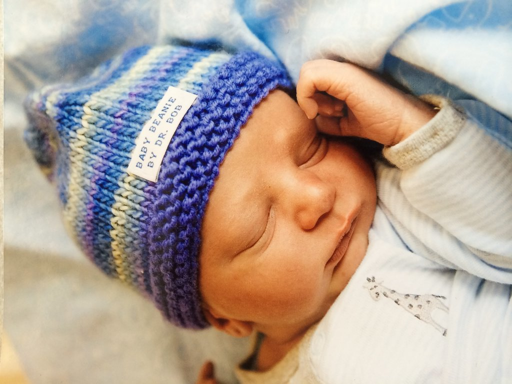 "Since starting his knitting adventure, Sansonetti has made more than 200 hats, each one taking about four hours to create. Though his job keeps him busy, Sansonetti finds time to knit while waiting for his patients to go into labor. But the gift is more than an act of kindness. It is also a medical necessity, as newborns can lose a lot of heat from their head and need to stay warm. While most hospitals provide hats for that purpose, Sansonetti says his ""give the baby a special, unique personality that doesn't seem to shine through with the standard hat."" Not to mention, it makes the mothers very happy.  Source: Dr. Robert Sansonetti"