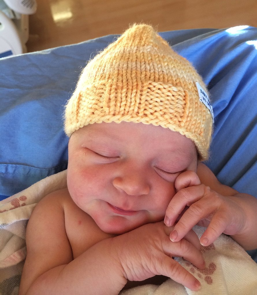 """I started by knitting a small hat in hopes of practicing before trying to knit a larger hat,"" Sansonetti says. ""It turned out pretty well, and by chance was the perfect size for a newborn."" The doctor decided to give the practice cap to the next baby he delivered. He recalls the look of surprise and delight on the mother's face, which he says prompted him to knit more miniature hats.  Source: Dr. Robert Sansonetti"