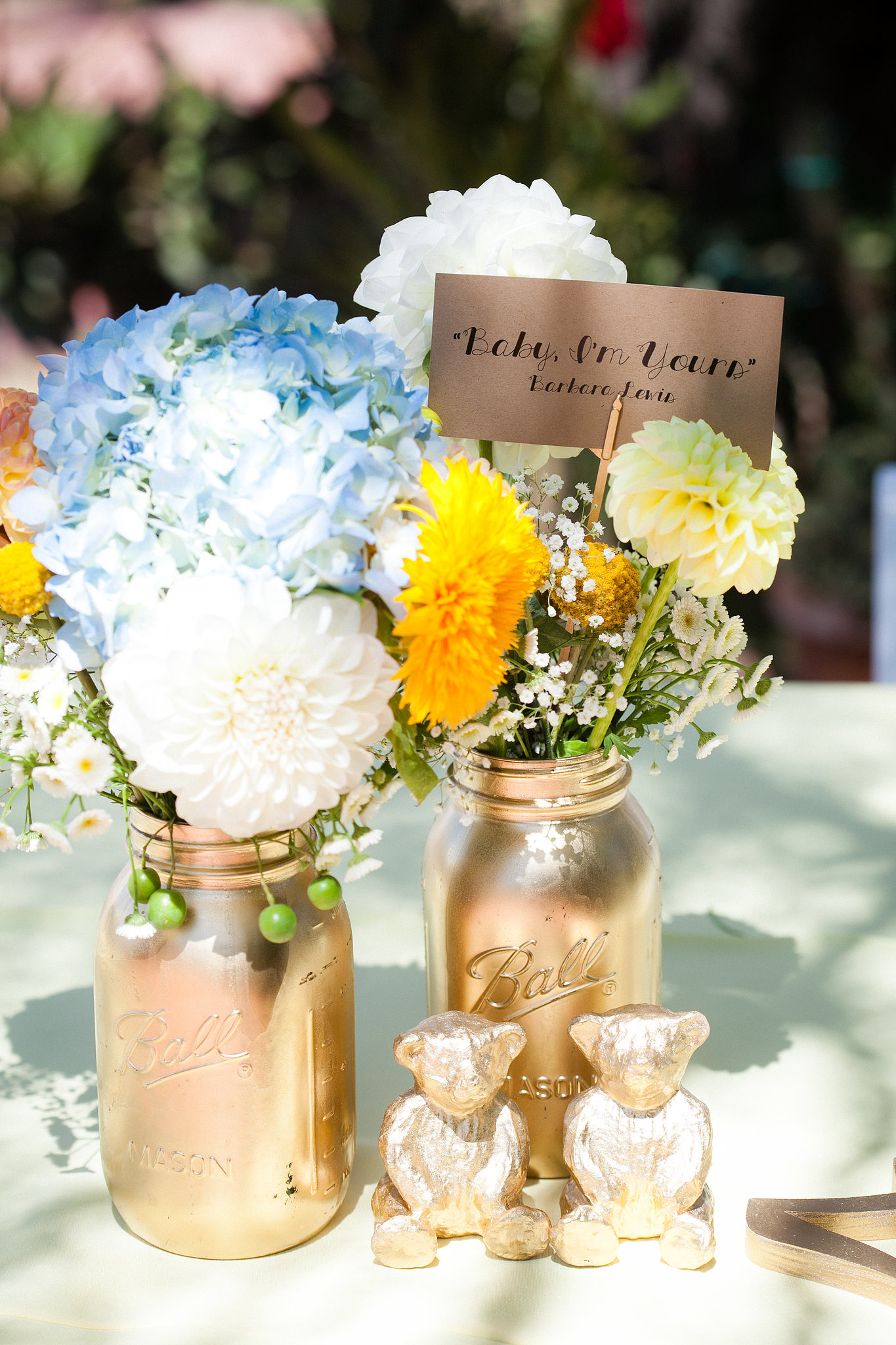"Did you take on any DIY projects? ""We went spray-paint crazy. Mason jars, table figurines, table name holders, you name it — I think Home Depot started to get suspicious. We also hand-drew hearts onto matchbooks and enlisted the bridal party to tie them to sparklers, which we placed at each table setting for guests to light later in the evening. Chanti designed the menus and itineraries, and we printed them out at FedEx, where we took advantage of the sheet cutter (not something I would recommend when you're short on time!). For favors, we bought miniature packets, which we decorated with cute kitten stamps (we have a cat hashtag on Instagram, #danteandcomma, so it seemed appropriate). We filled them with flower seeds, wrote 'California Paw-pies' on the front, and sealed them with a Golden Gate bridge stamp on the back."" Photo by G Aranow Photography"