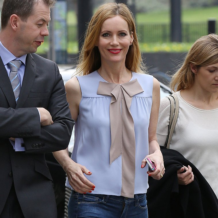 Leslie Mann Wearing Pastel Shirt and Leopard Pumps