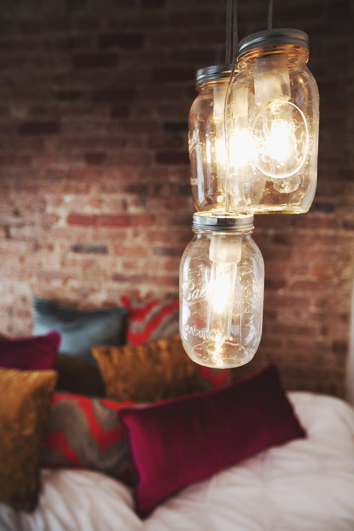 A mason jar DIY offers affordable lighting.  Photo by Chellise Michael via Homepolish