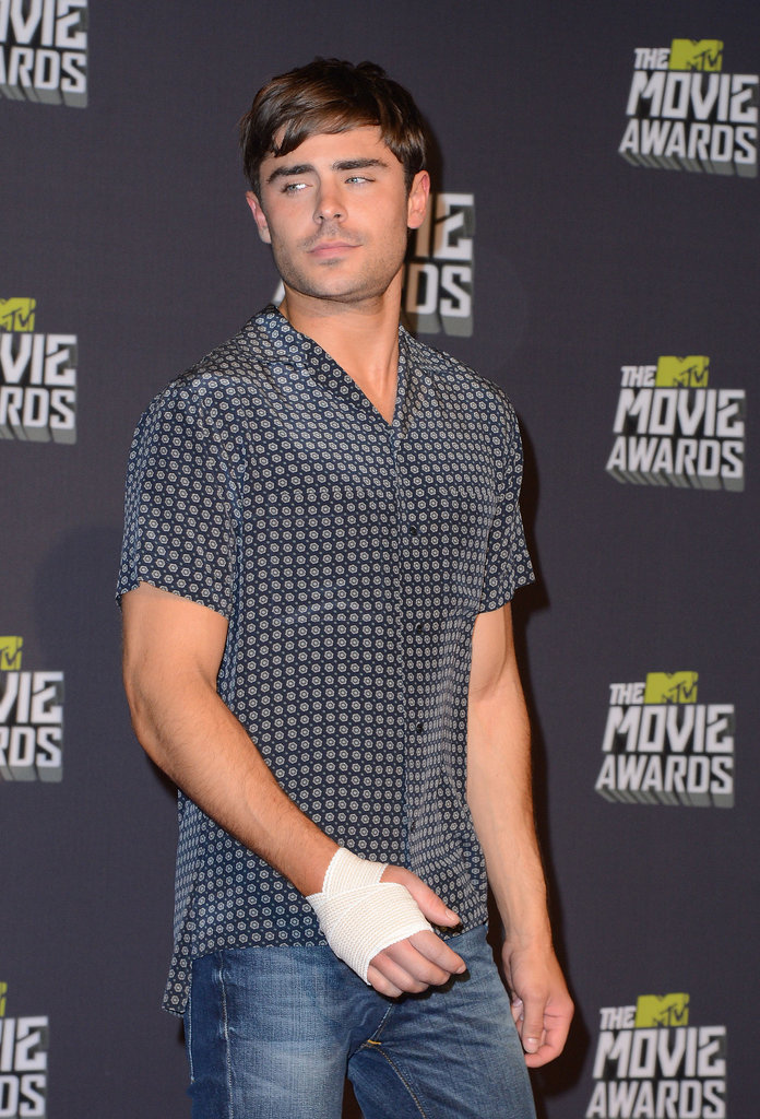 It was three years before he returned to the MTV Movie Awards in 2013. And he had a broken hand!
