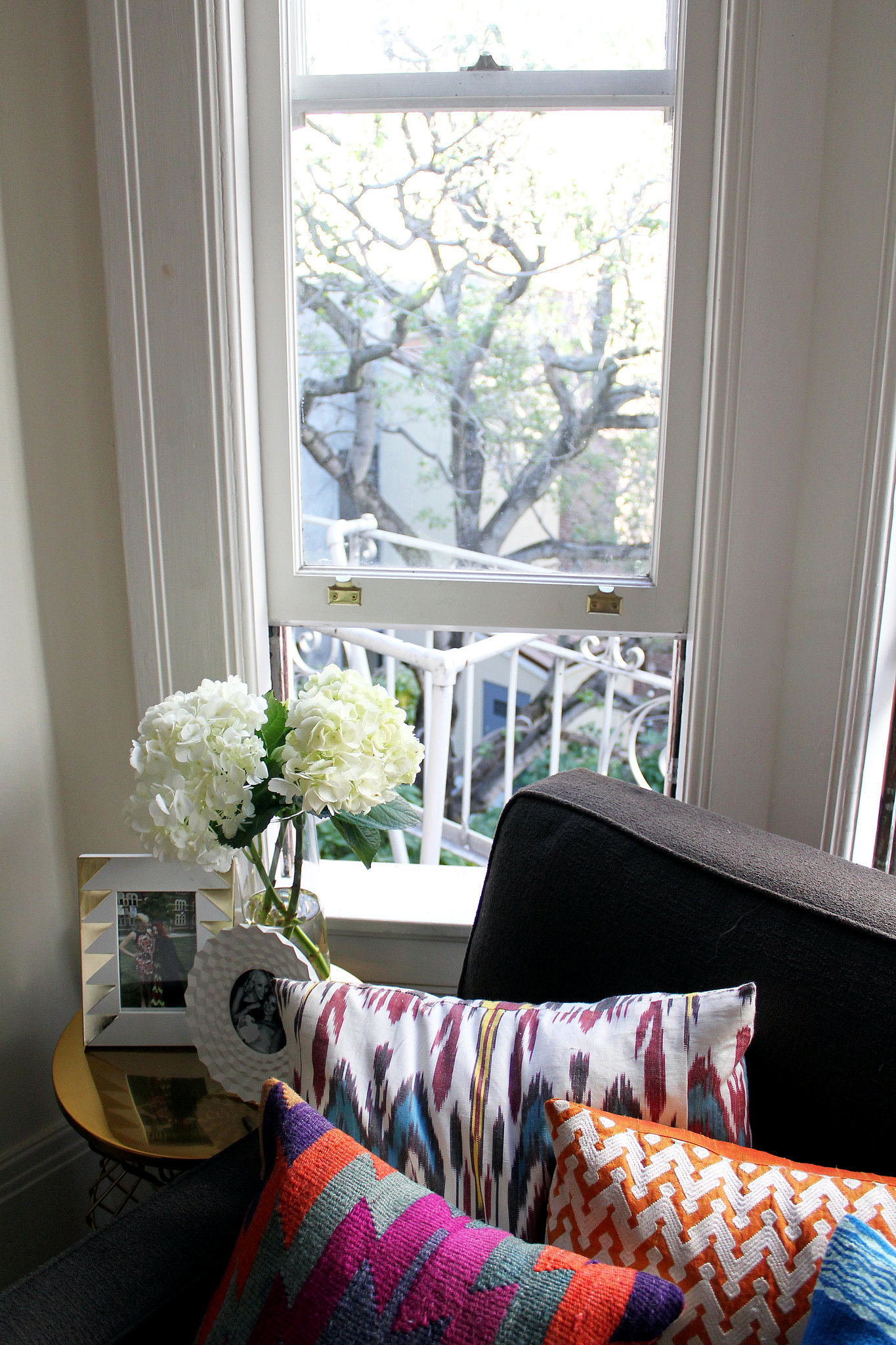 How great are her bright pillows? One piece of advice she has for anyone trying to figure out their decorating style is to start with a basic foundation (a neutral couch, for instance) and add pizzazz through accents.