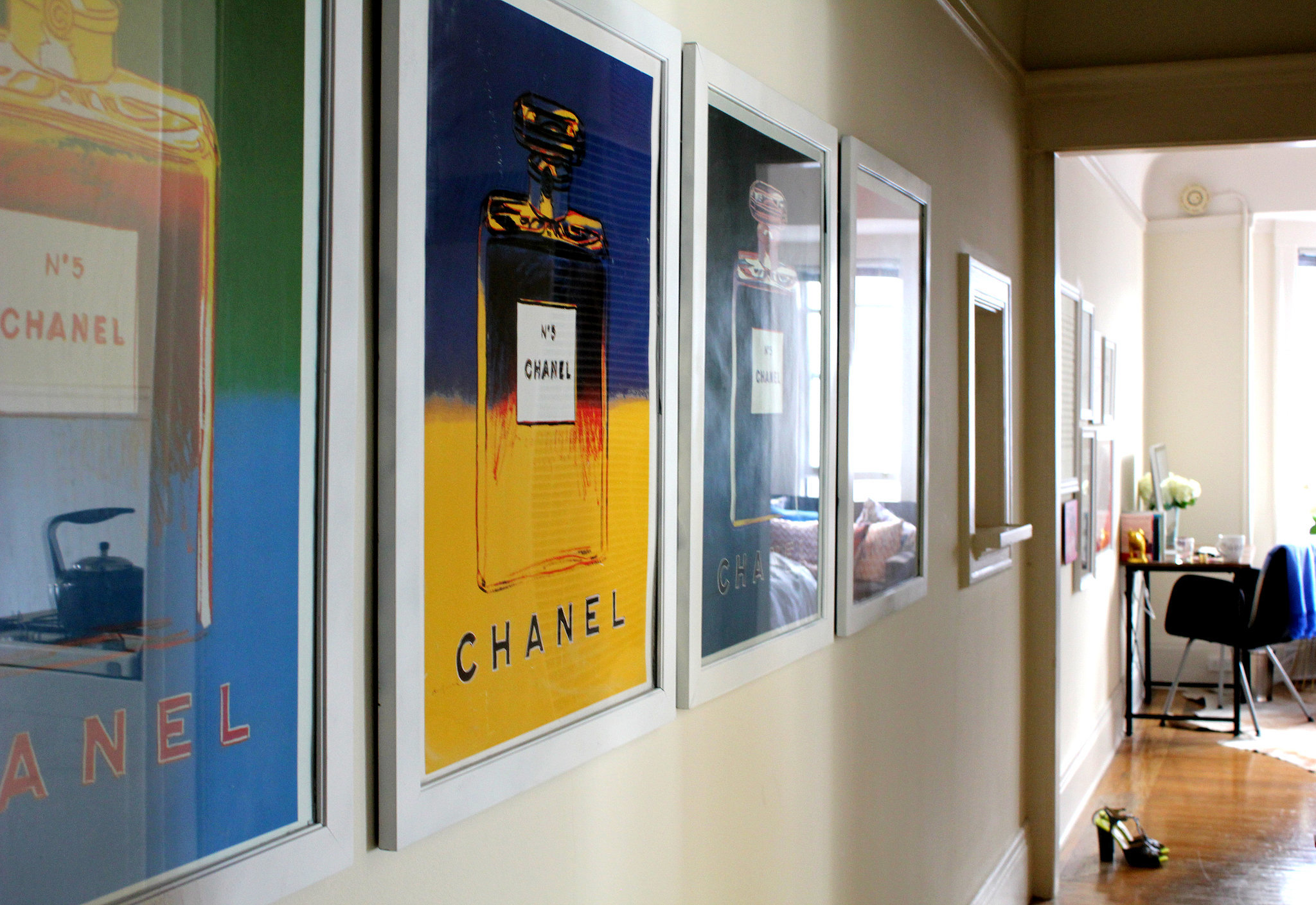 "As soon as you step inside the apartment, you can't help but notice these amazing Chanel prints by Andy Warhol. Turns out Emily's had them since she was 17 years old and saved her money for two years to buy the whole set. ""I could never live without them,"" she says. Can you blame her?"